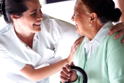 Nurse assisting senior